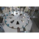 Mašina za punjenje i zatvaranje i zatvaranje tekućih sredstava protiv komaraca
